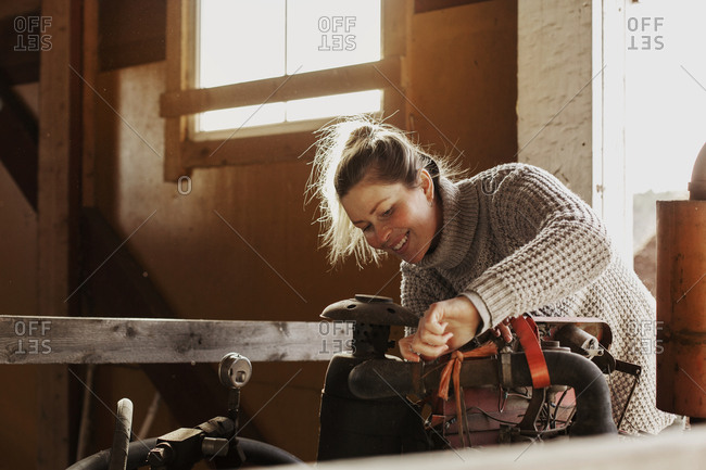 Smiling woman using machinery