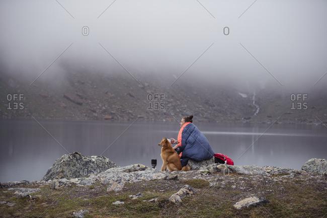 Woman with dog at lake