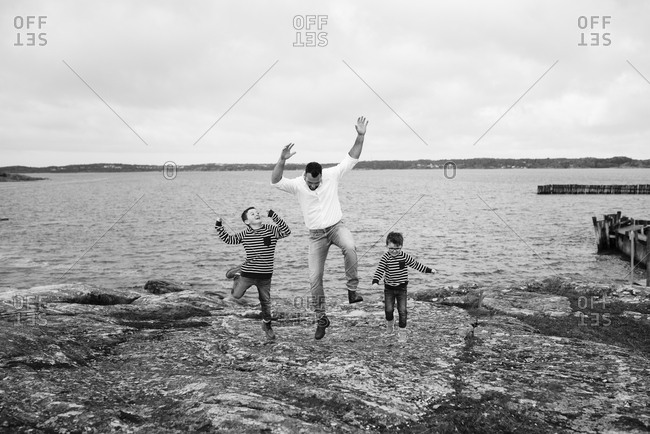 Father with sons at sea