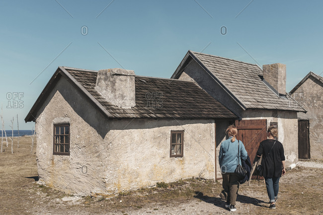 Women near old house