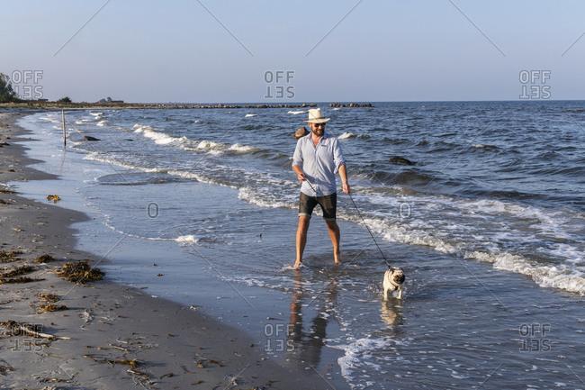 Man with pug at sea