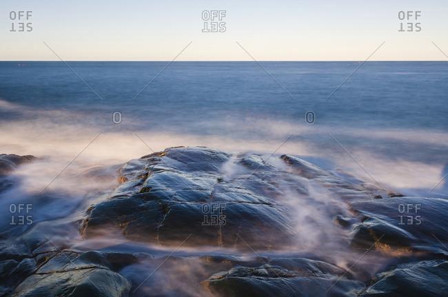 Rocky coast with water splashing