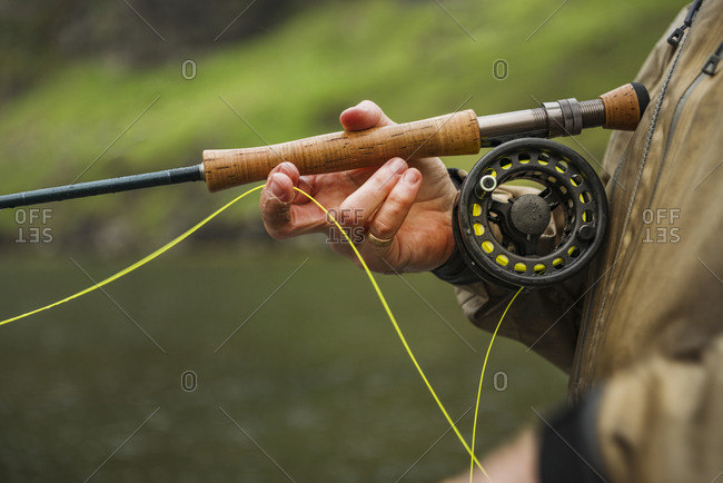 Hand with fishing rod