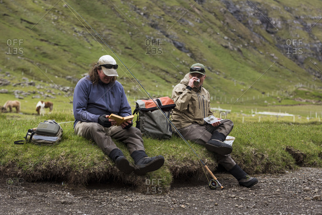 Anglers relaxing near water