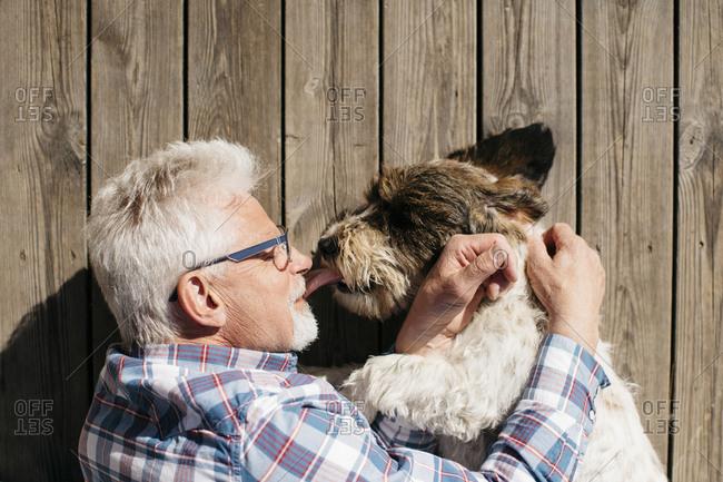 Senior man with dog - Offset
