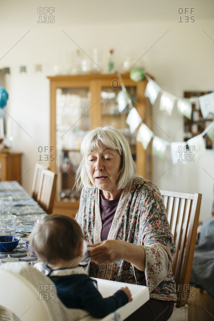 Grandmother feeding grandchild - Offset Collection