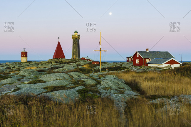 Lighthouse and buildings at dusk