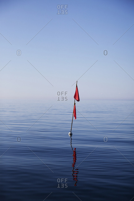 Buoy with red flag