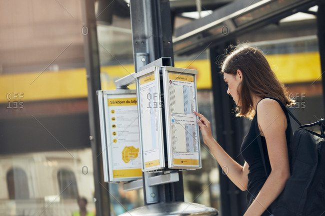 Woman checking timetable