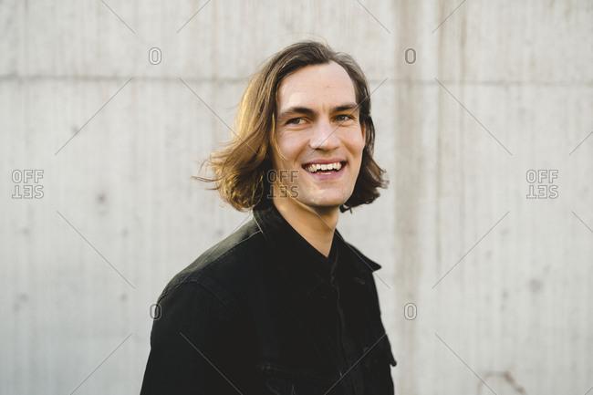 Smiling man enjoying time by himself