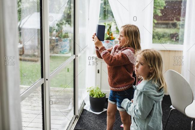 Girls looking through window