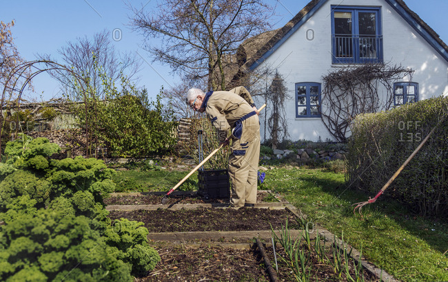 Man gardening out in nature