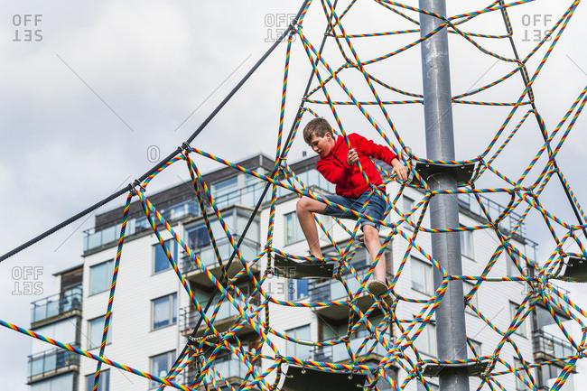 Boy on climbing frame