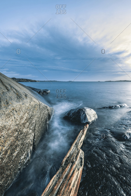 Rocky coastline with a clear sky in the background