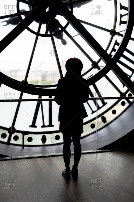 Woman in clock tower
