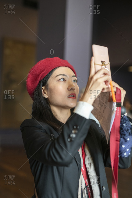 Woman photographing with cell phone
