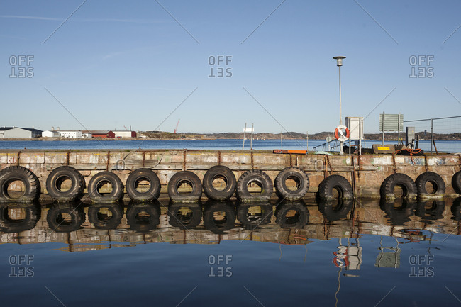 Tires hanging on jetty