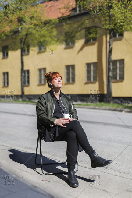 Woman having coffee outdoors