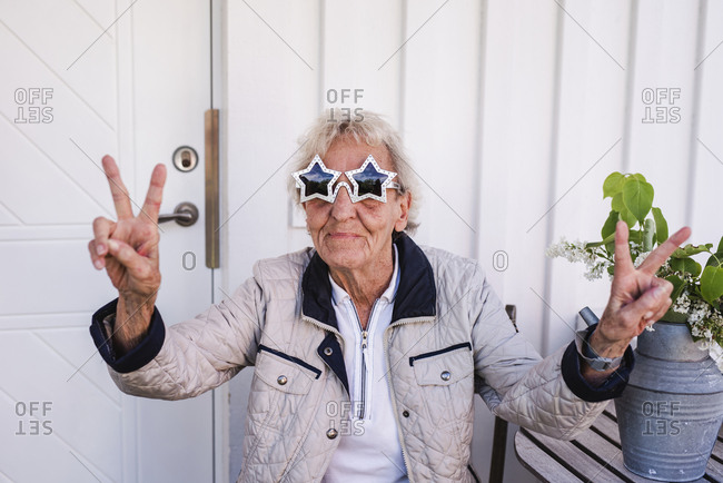 Woman wearing star-shaped sunglasses