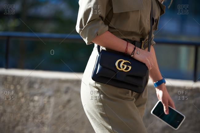 September 14, 2019 - London: Stylish wearing khaki military style jumpsuit and Gucci bag