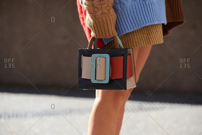 September 14, 2019 - London: Stylish woman wearing oversized sweater, holding miniature BOYY bag