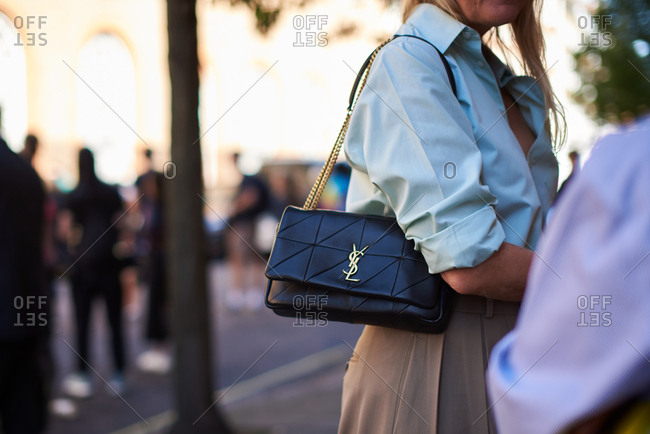 September 14, 2019 - London: Stylish woman wearing aqua shirt and black YSL handbag