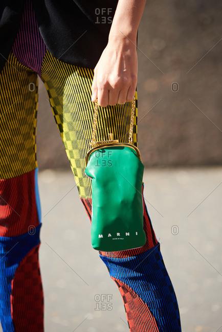 September 14, 2019 - London: Fashionable woman wearing multicolored leggings, holding Marni miniature bag