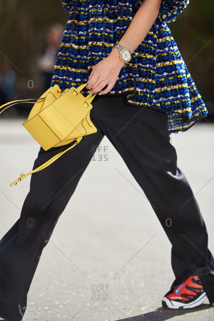 September 14, 2019 - London: Fashionable woman walking to fashion show carrying vivid Loewe miniature bag