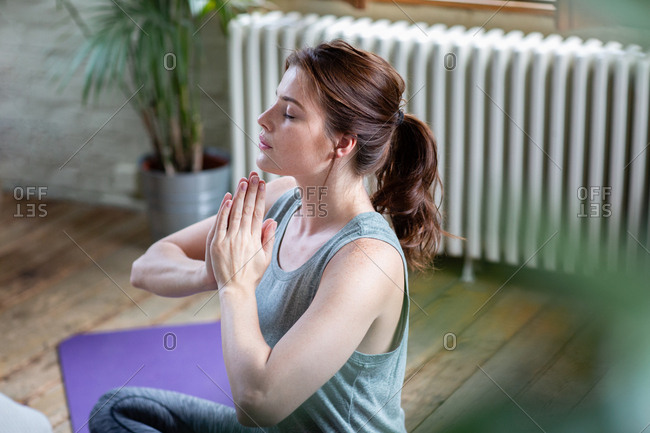 Young adult female practicing yoga