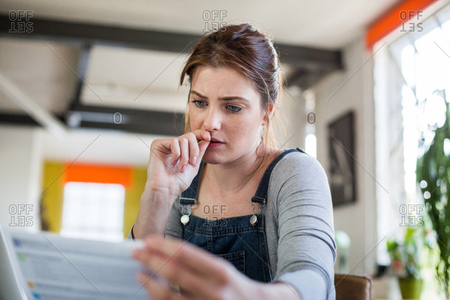 Young adult female online banking