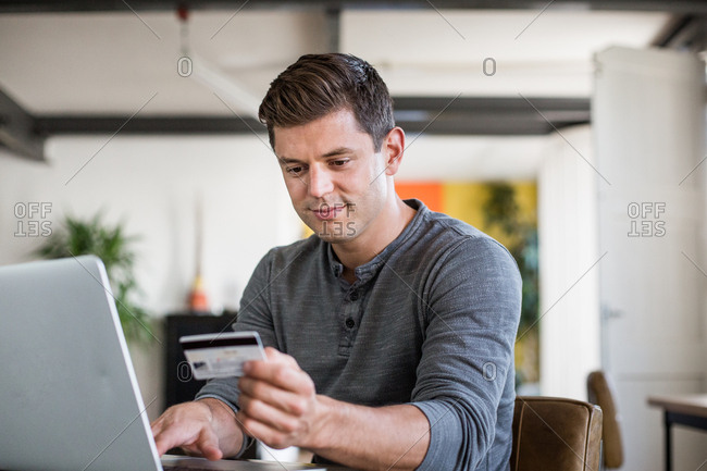 Adult male using credit card online