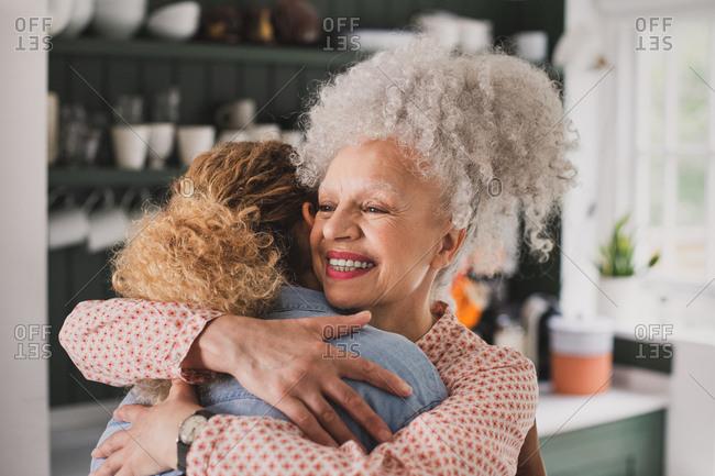 Senior adult woman hugging daughter