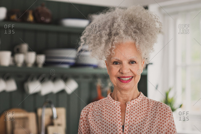 Portrait of mixed race senior adult woman at home