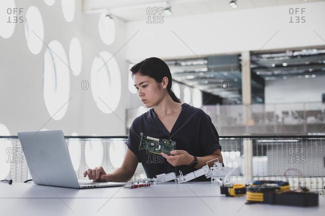 Female working on robotics - Offset