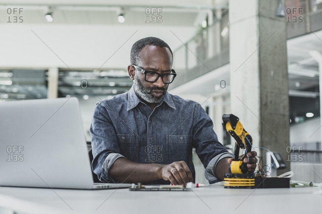 African American adult male working on robotics