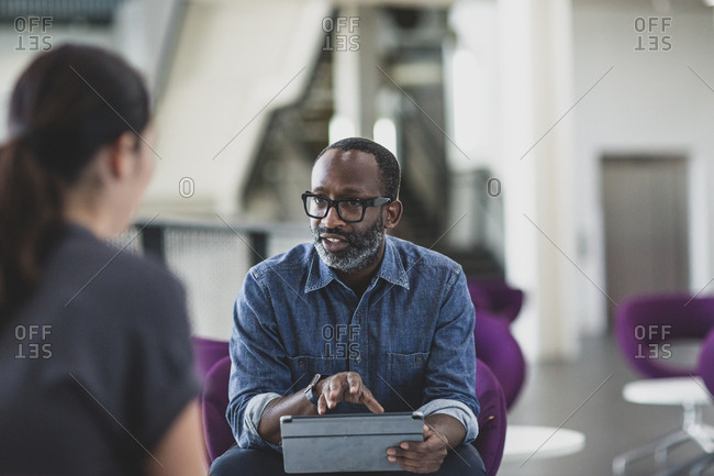African American businessman using a digital tablet in a meeting