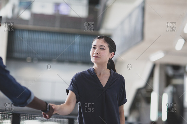 Young adult businesswoman shaking hands