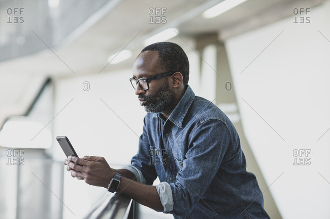 African american businessman using smartphone