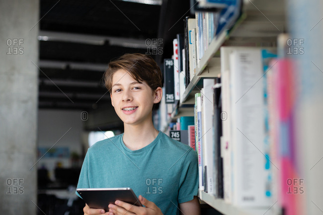 Portrait of high school student in library