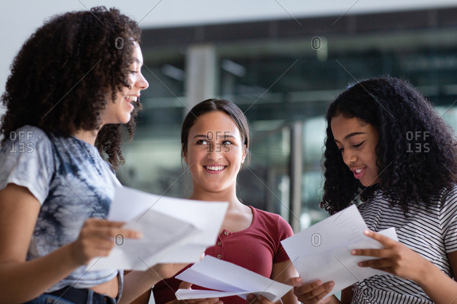 Female High school students opening their exam results