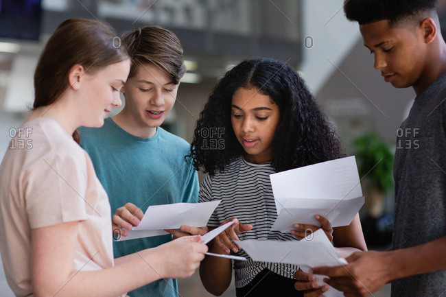 High school students opening their exam results