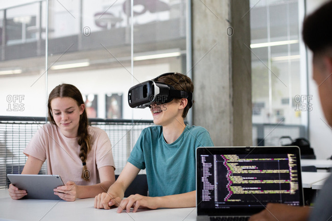 High school students using VR headset in class