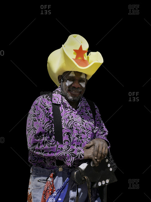 United States, Arizona, Chandler - March 9, 2019: Portrait of a rodeo clown against black in available light