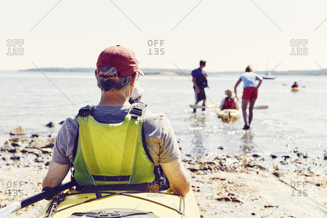 Family prepares to go kayaking in Casco Bay, Maine after renting kayak