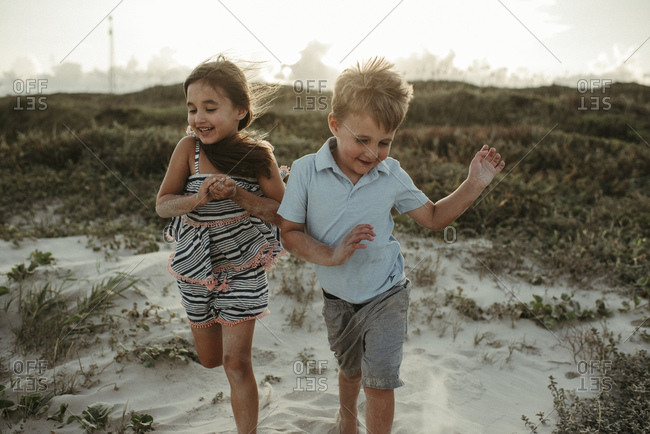 Kids Playing in Dunes at the Beach in Corpus Christi Texas