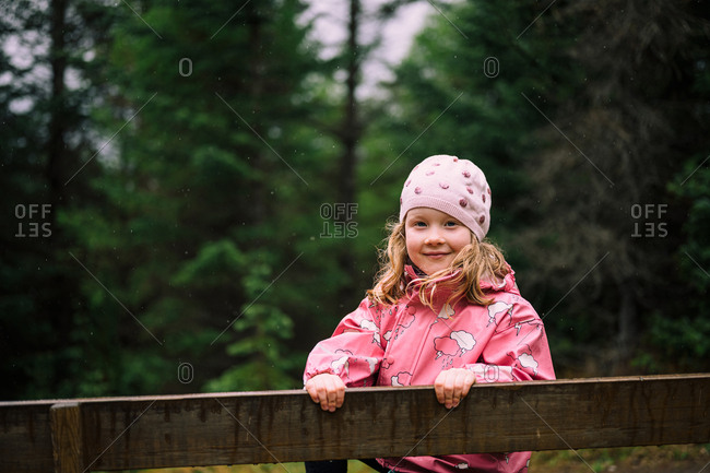 Cute girl in green Icelandic forest