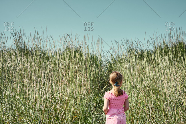Little girl thinking about taking unfamiliar trail