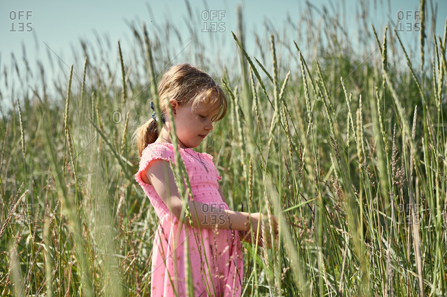 Thoughtful little cute girl in Icelandic field