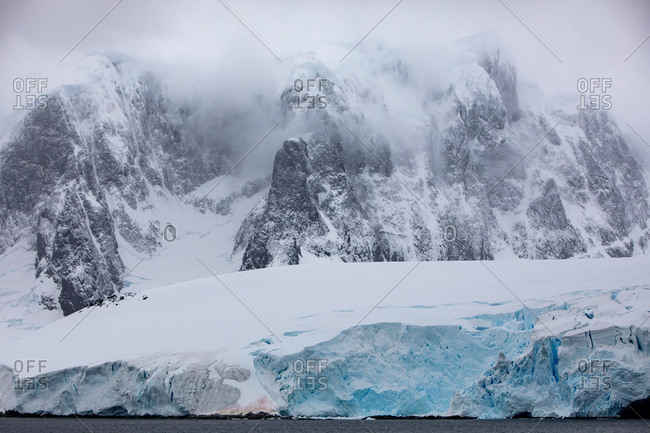 Ice shelf and snowy mountains