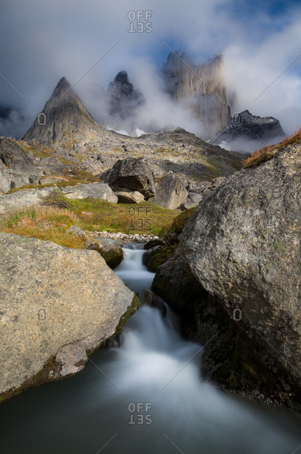 Rushing stream at the base of stormy mountains, greenland
